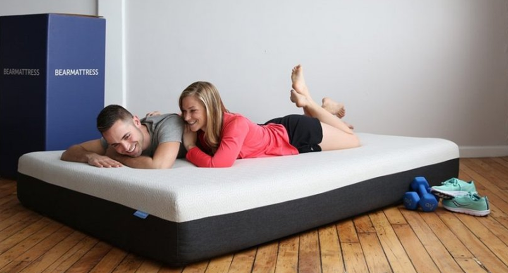 Image of two people on a Bear mattress