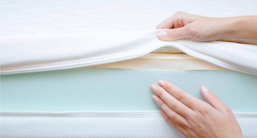 hands showing polyurethane foam matterass