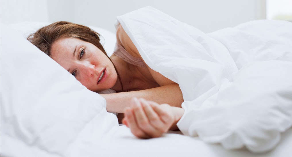 women hot sleeper having difficulty sleeping