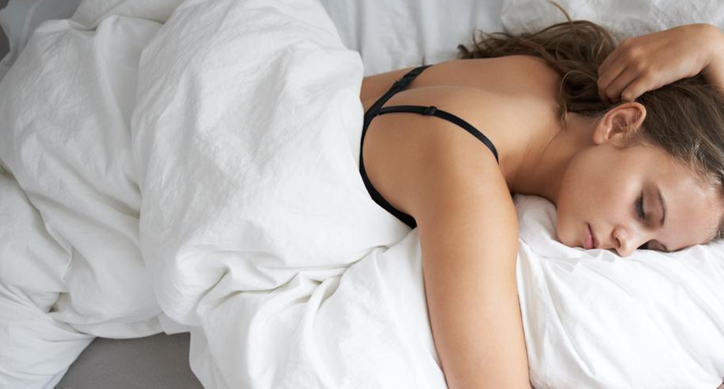 Image of someone sleeping on their stomach