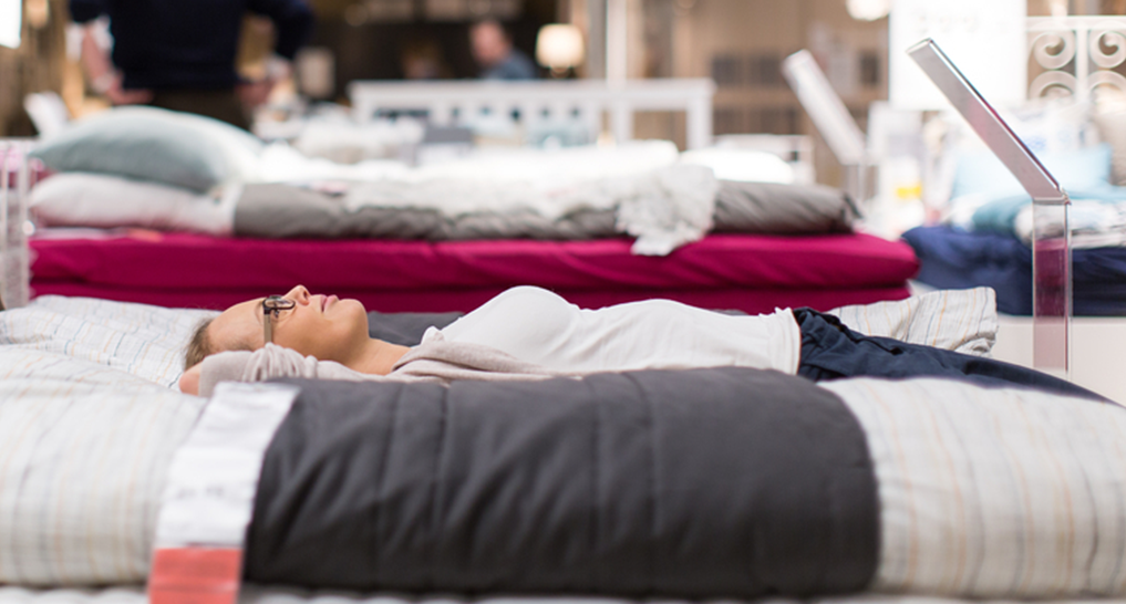 People testing mattress at the store.