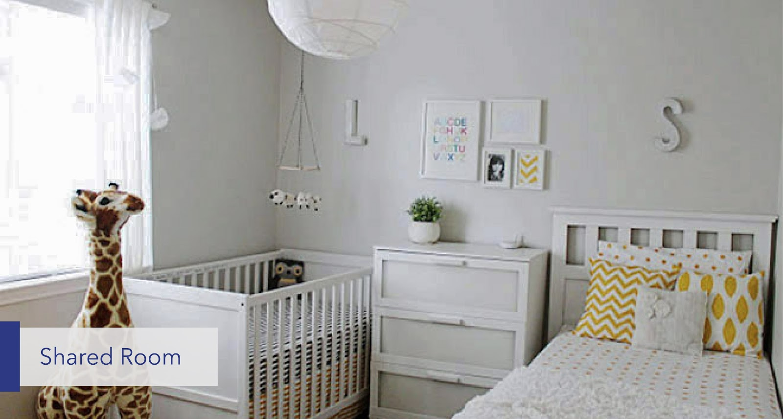 bed and crib in the same room