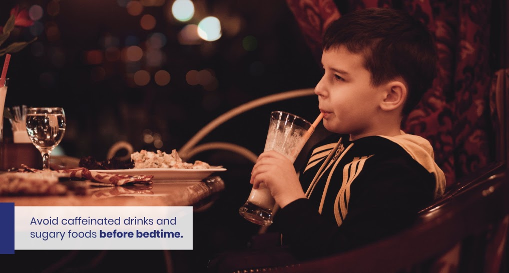 Kid eating sugar before bed - like this - Text: Avoid caffeinated drinks and sugary foods before bedtime.