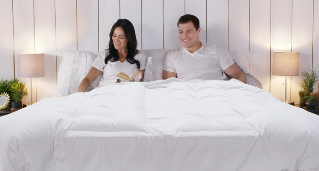 couple doing their own thing in bed