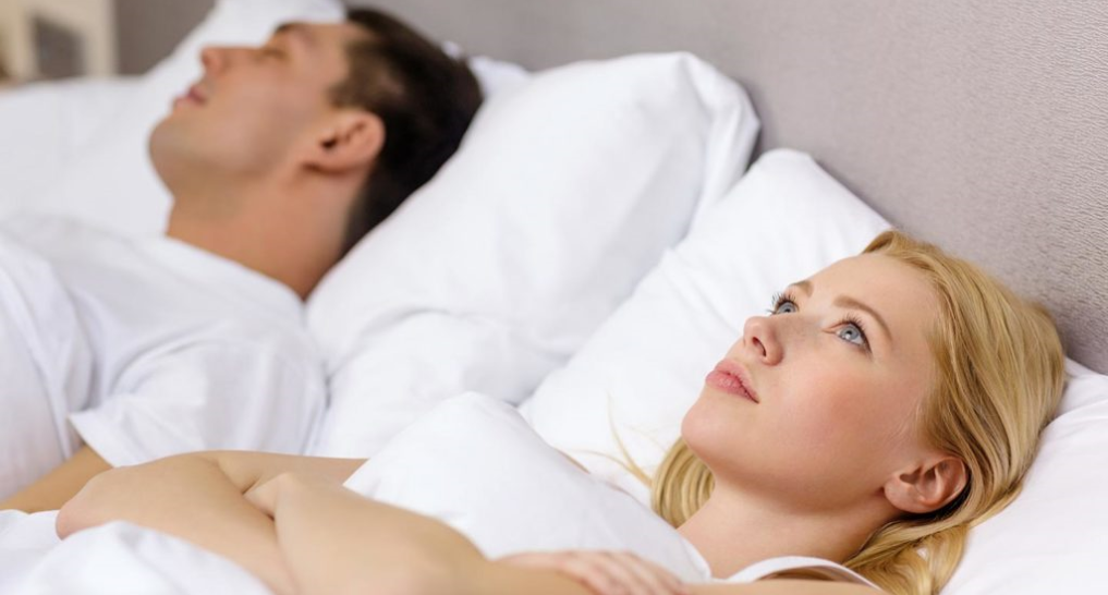 person awake while partner sleeps