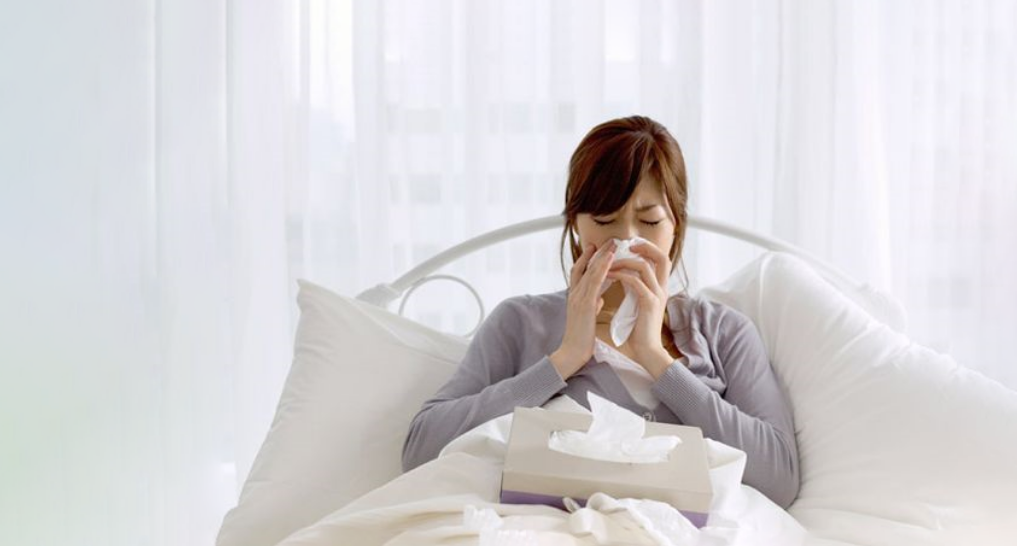 someone with allergies in bed