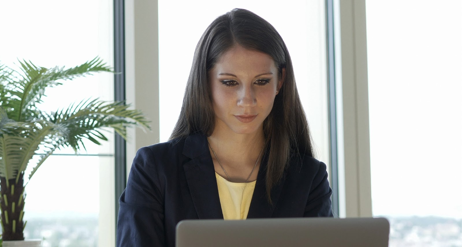 woman searching online with a serious look