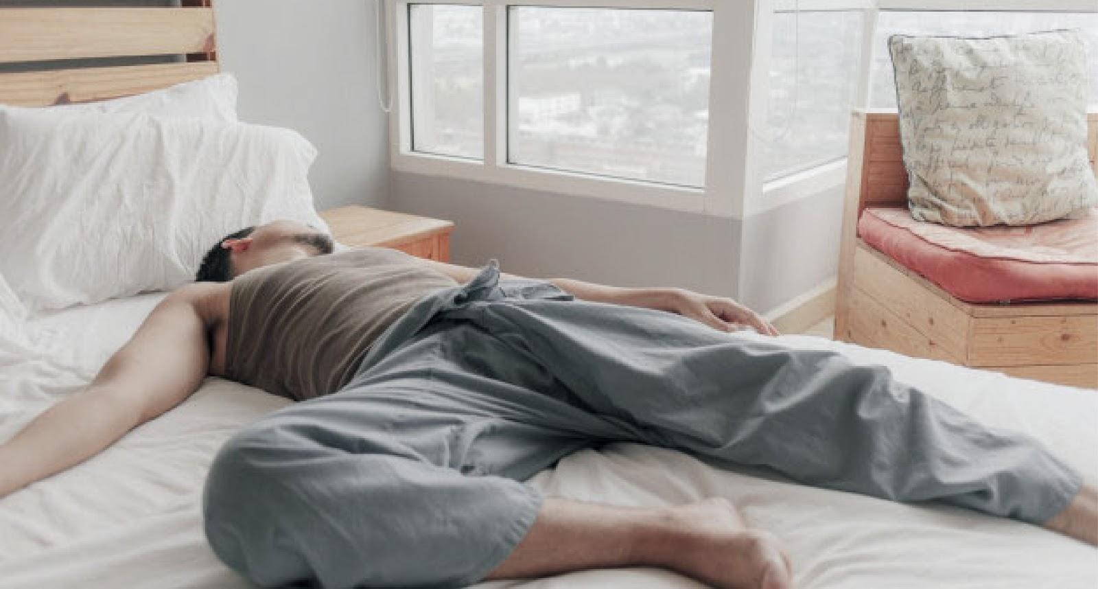 a man laying on mattress