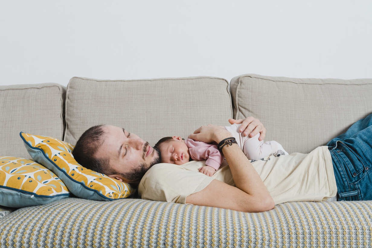 father and child napping