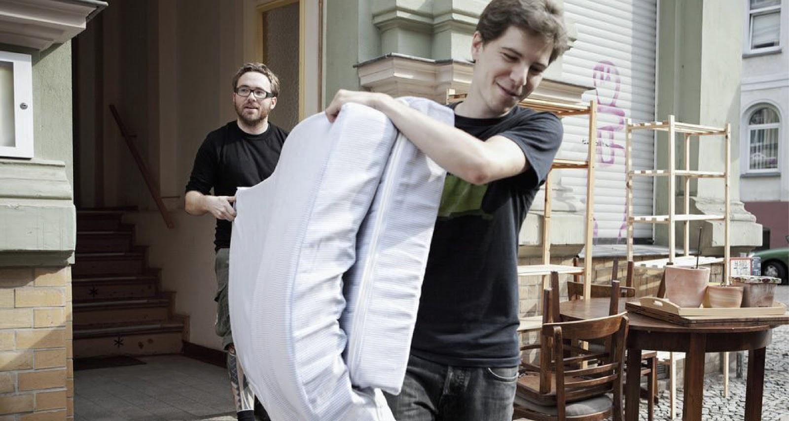 men carrying a mattress