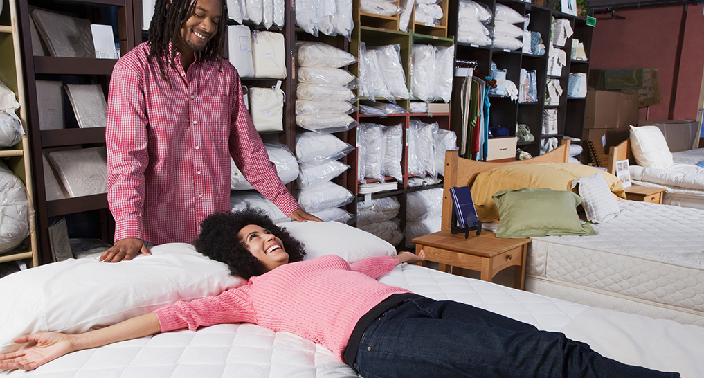 Image of people mattress shopping