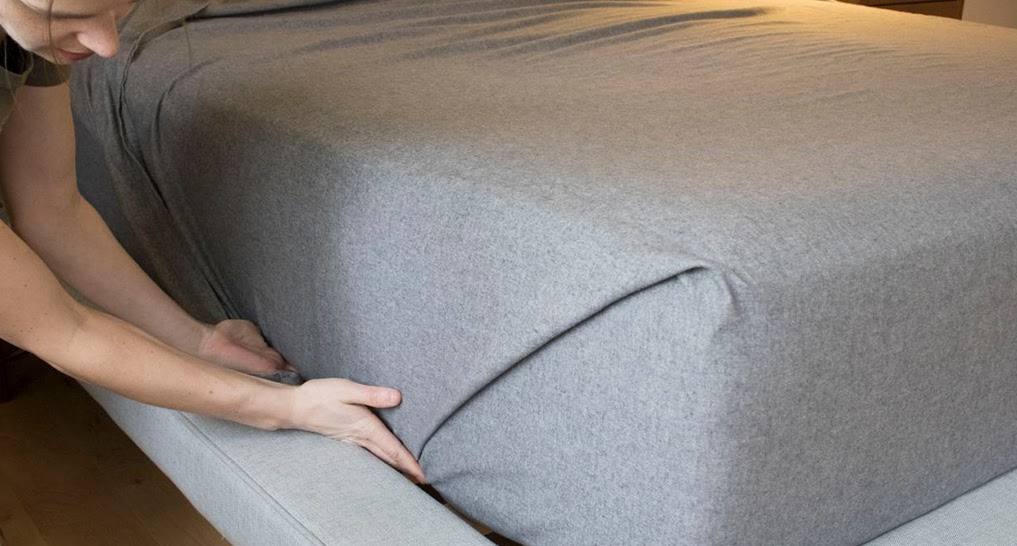 Image of someone using their mattress or putting on sheets