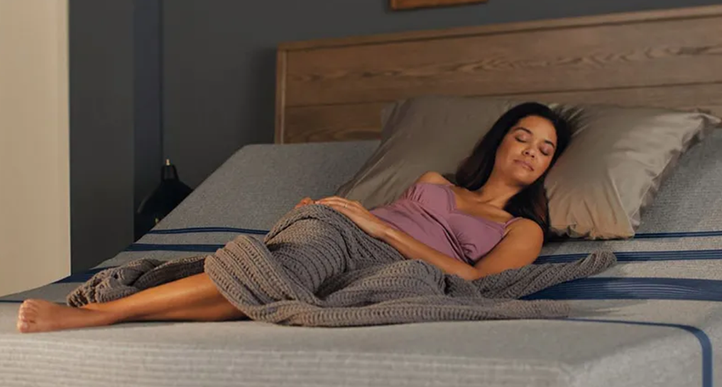 someone laying on a luxurious looking mattress